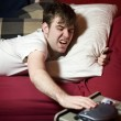 Grumpy young man waking up — Stock Photo #5852422