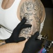 Arm of man getting tattooed — 图库照片