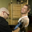 Client in pain getting a tattoo — Stock Photo