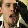 Man about to get his tongue pierced - Stock Photo