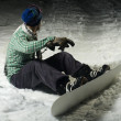 Stock Photo: Snowboarder sitting in snow