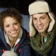 Beautiful couple playing in the snow together — Stock Photo