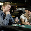 Two young poker players - Stock Photo