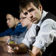 Man waiting with his friends at bar — Stock Photo