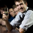 Man smiling for the camera at bar — Stock Photo
