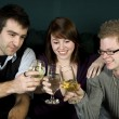 Three friends toasting — Stockfoto