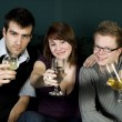 Three friends toasting to the camera — Stock Photo