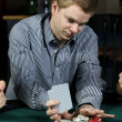 Young poker player going all in — Stok fotoğraf