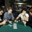 Four friends playing poker — Stock Photo