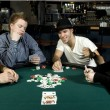 Four friends around table playing poker — Stock Photo #5852603
