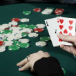 Woman holding poker hand — Stock Photo