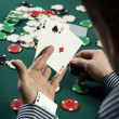 Poker player with ace up his sleeve - Stok fotoğraf