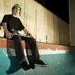 Skateboarder sitting on top of mini ramp — Stock Photo