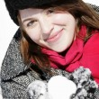 Woman holding snowball smiling — Stock Photo #5852676