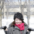 Beautiful girl throwing snow in the air — Stock Photo