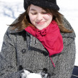 Woman holding snowball enjoying winter — Stock Photo #5852683