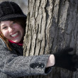 Beautiful girl hugging tree — Stock Photo