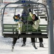 Two sisters on chair lift - Stock Photo
