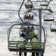 Chairlift full of - Stock Photo
