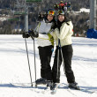 Stock Photo: Two sisters skiing together