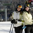 Two beautiful girls skiing together — Stock Photo