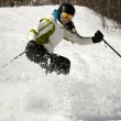 Girl skier stopping on slope — Stock Photo #5852806