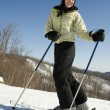 Woman happy to be outside skiing - Stock Photo