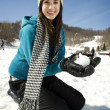 Stock Photo: Young girl playing in snow at ski resort