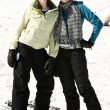 Two beautiful girls dressed in ski suits — Stock Photo