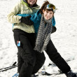 Two sisters playing around in snow — Stock Photo #5852840