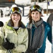 Two beautiful girls holding there skis — Stock Photo #5852842