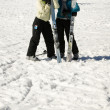 Two girls standing together in snow — Stock Photo