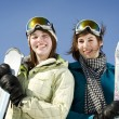 Portrait of two girls holding there skis — Stock Photo #5852845