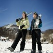 Two girl skiers hanging out - Stock Photo