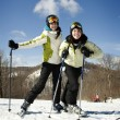 Two young girls skiing together — Stock Photo