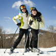 Two beautiful girls skiing — Stock Photo