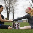 Two joggers stretching before there jog — Stock Photo