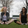Stock Photo: Two young women stretching in park before jog