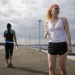 Two women joggers on water break — Stock Photo #5852888