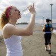 Two women jogging and taking a water break — Stock Photo #5852889