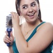 Young brunette brushing her hair — Stock Photo #5852968