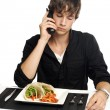 Young man on phone about to eat — Stock Photo