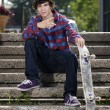 Young skateboarder looking at camera — Stock Photo #5853252