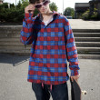 Fashionable skateboarder standing in parking lot — Stock Photo #5853263
