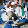 Urban dancer showing off shoes — Stock fotografie