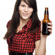 Young beautiful woman with beer bottle - Stock Photo