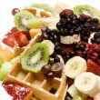 Waffle plate garnished with fresh fruit — Stock Photo