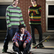 Three skateboarder friends standing together — Stock Photo #5853484