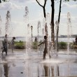 Children playing in battery park — Stock Photo