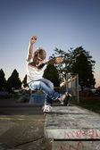 Inline Skater doing a grind on bench — Stock Photo